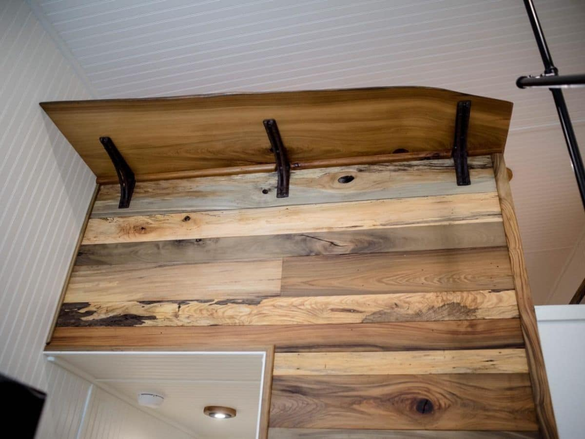 shelf above reclaimed wood wall in tiny home