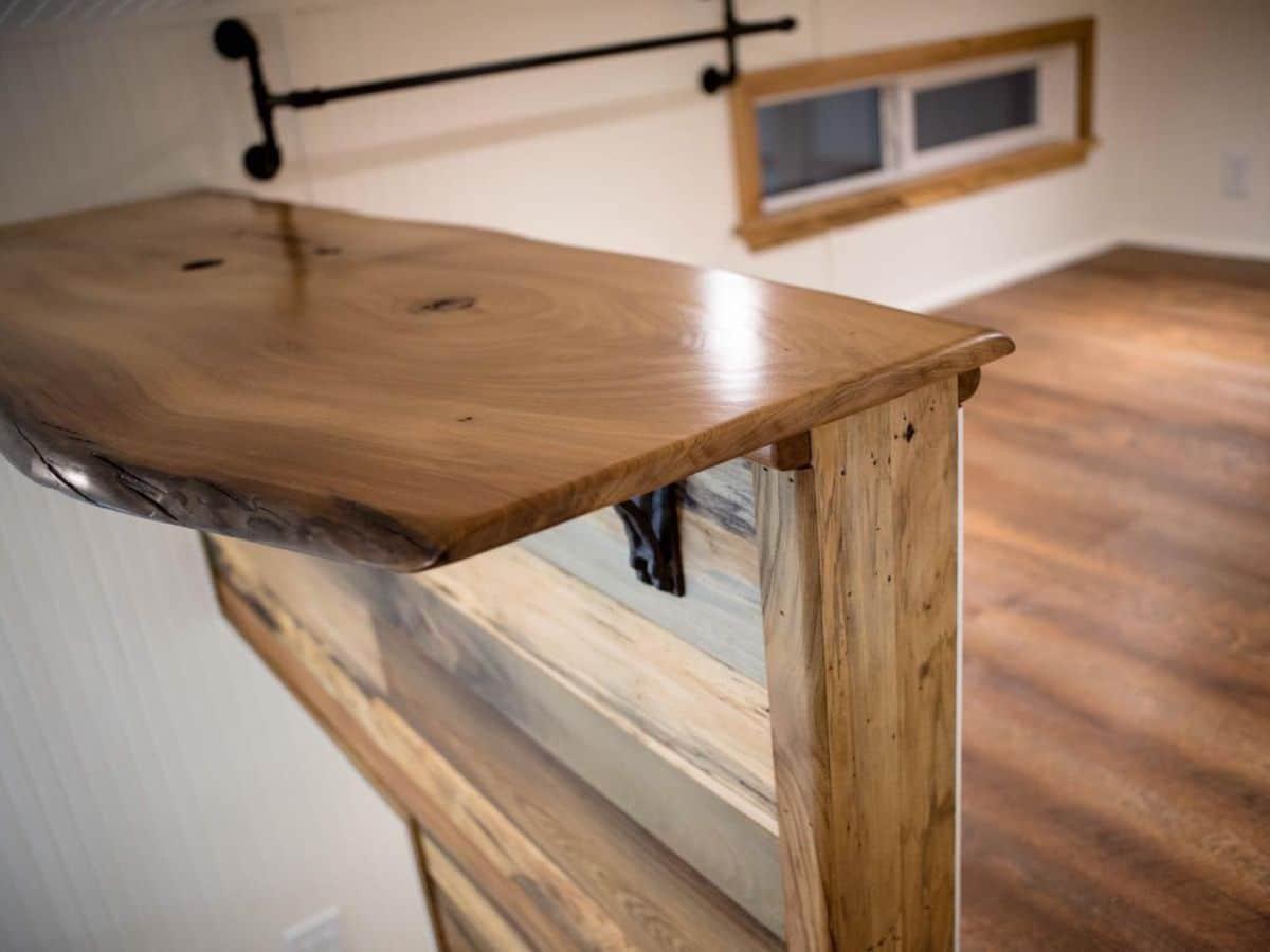 shelf inside tiny loff with wood lfoors