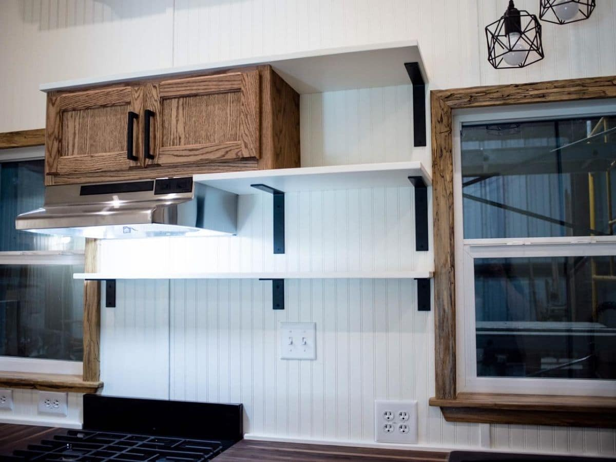 white shelves by wood cabinet in kitchen