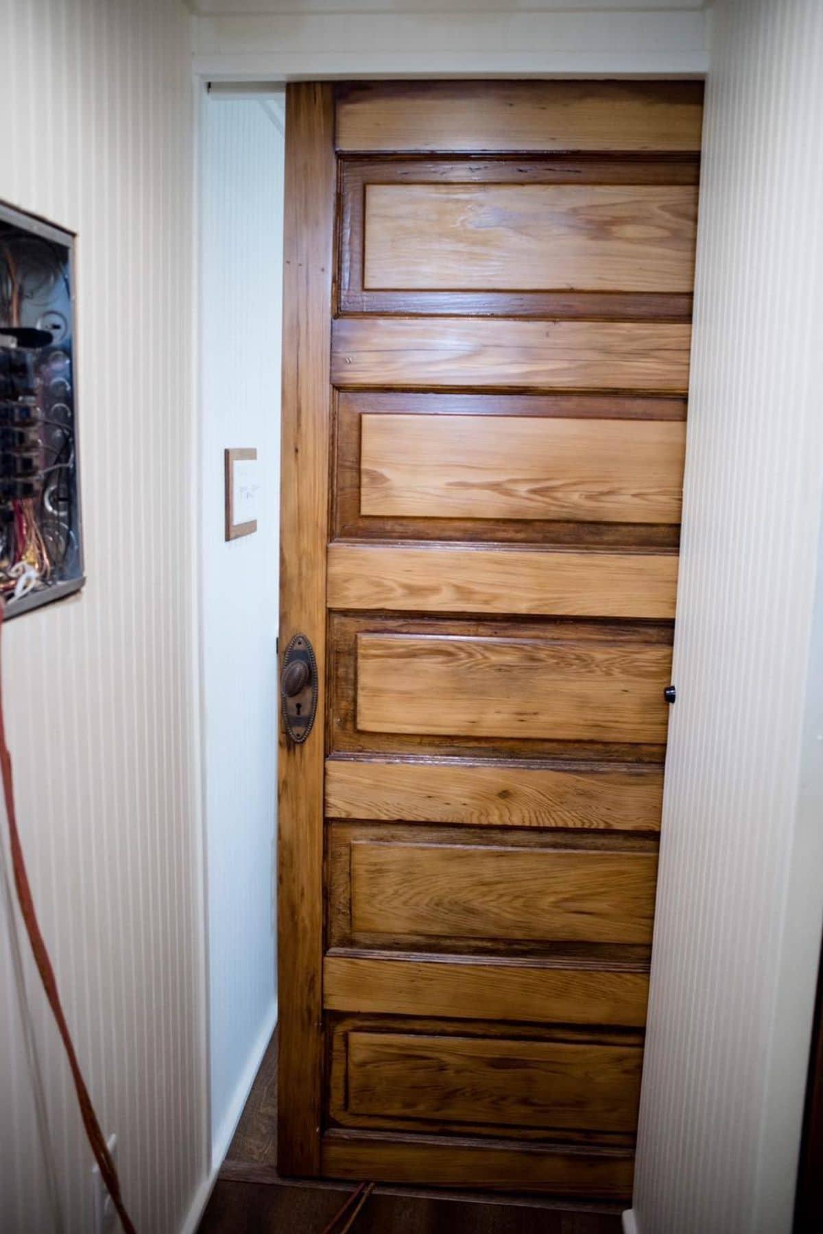wood door to bathroom closing