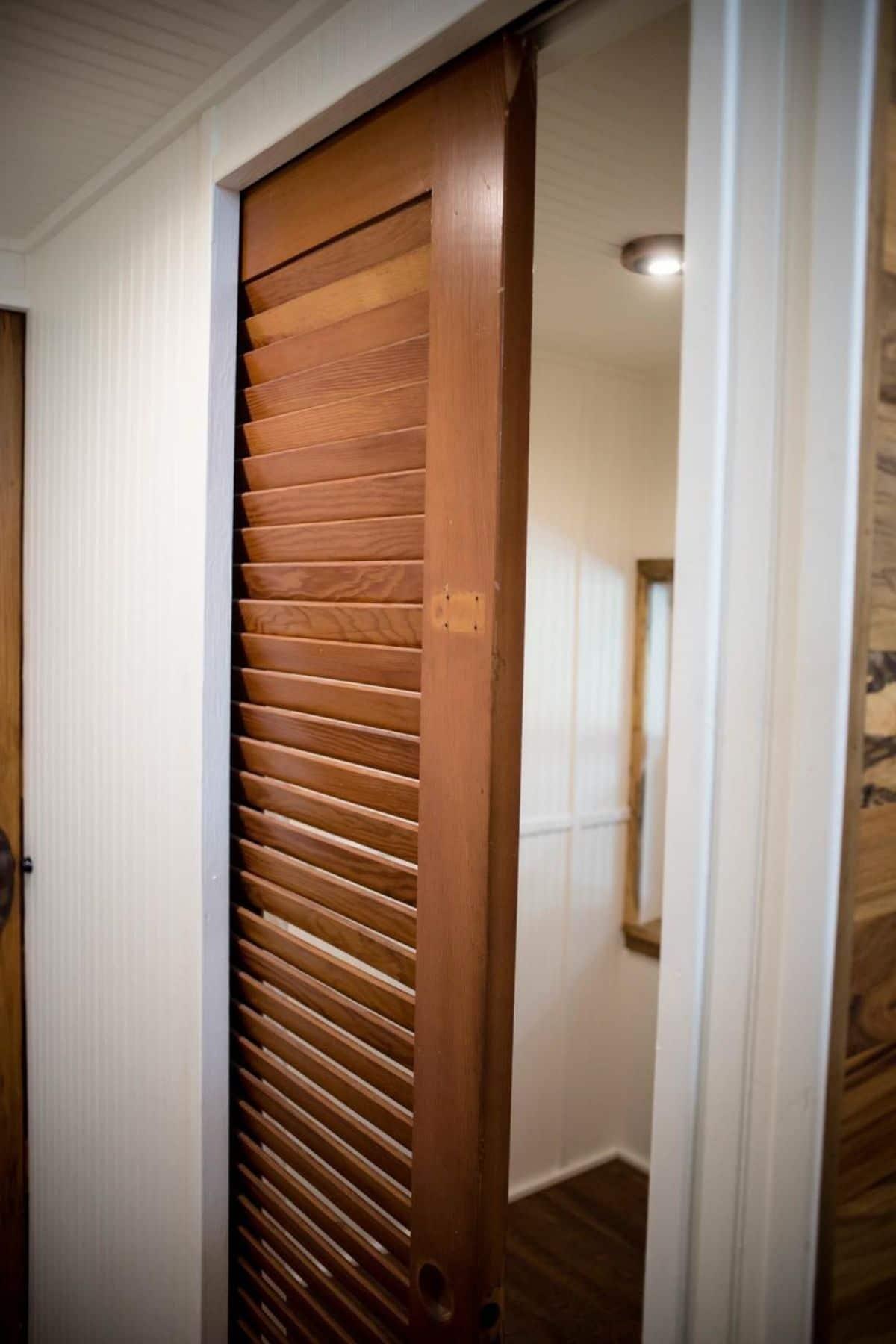 door half open to small bedroom