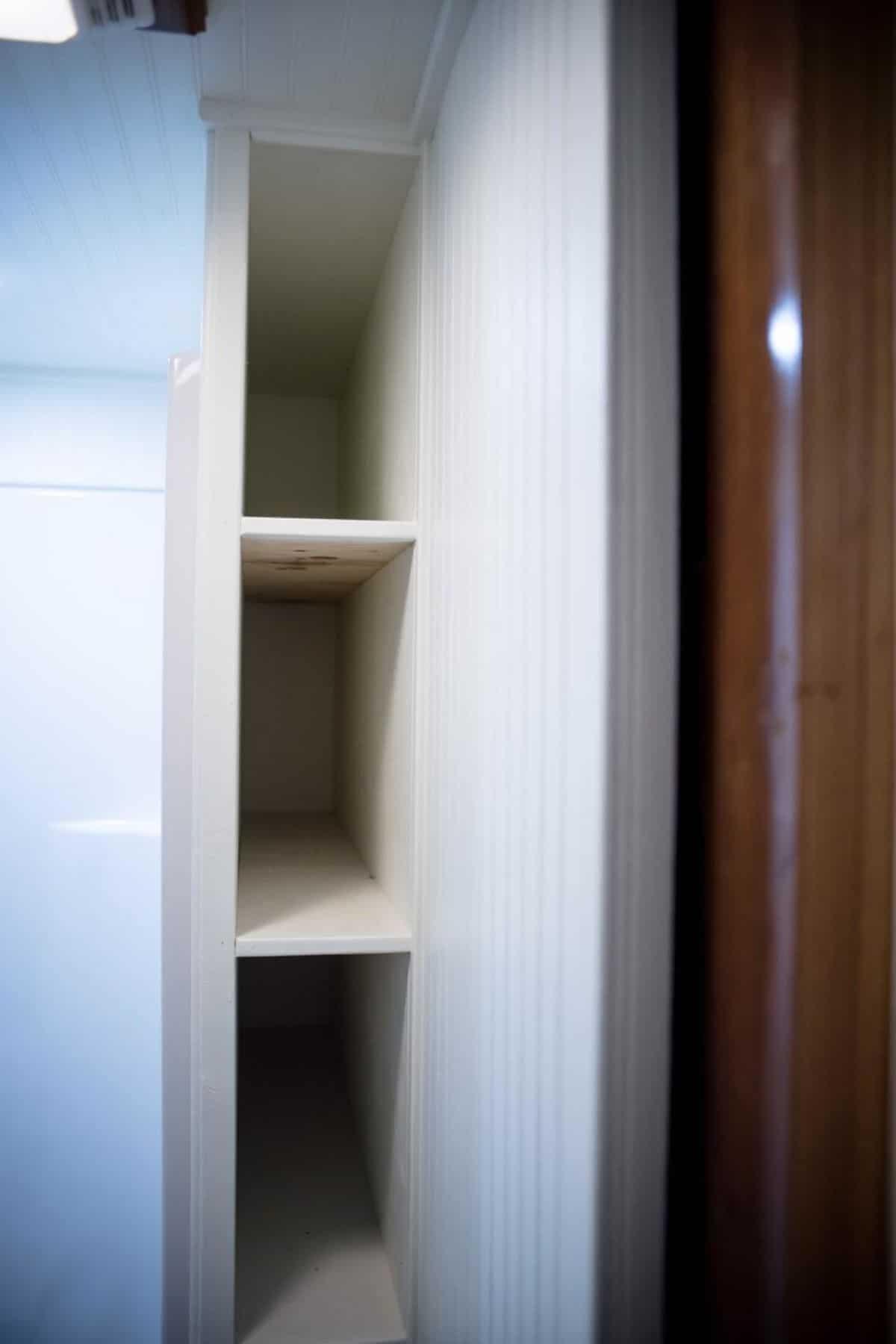 storage beside shower in bathroom