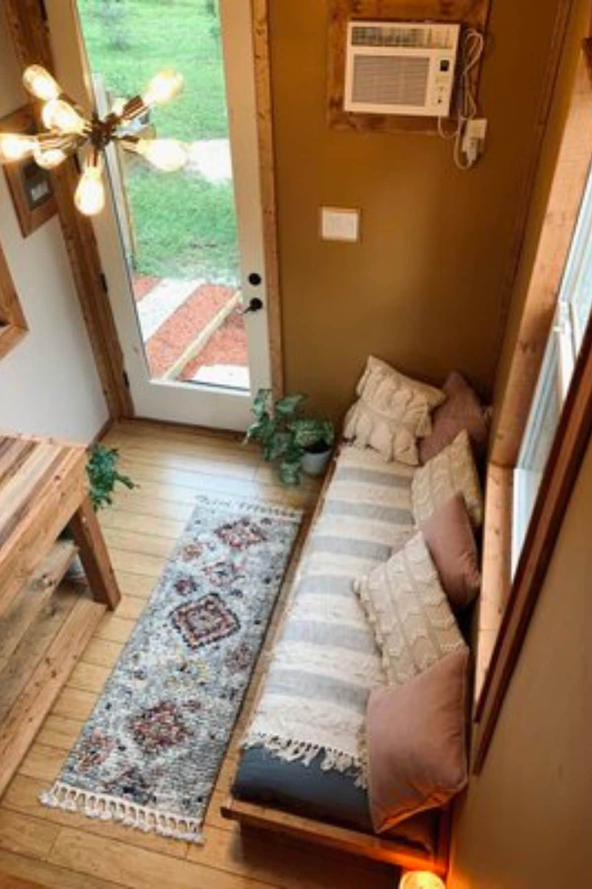 View down to sofa from loft