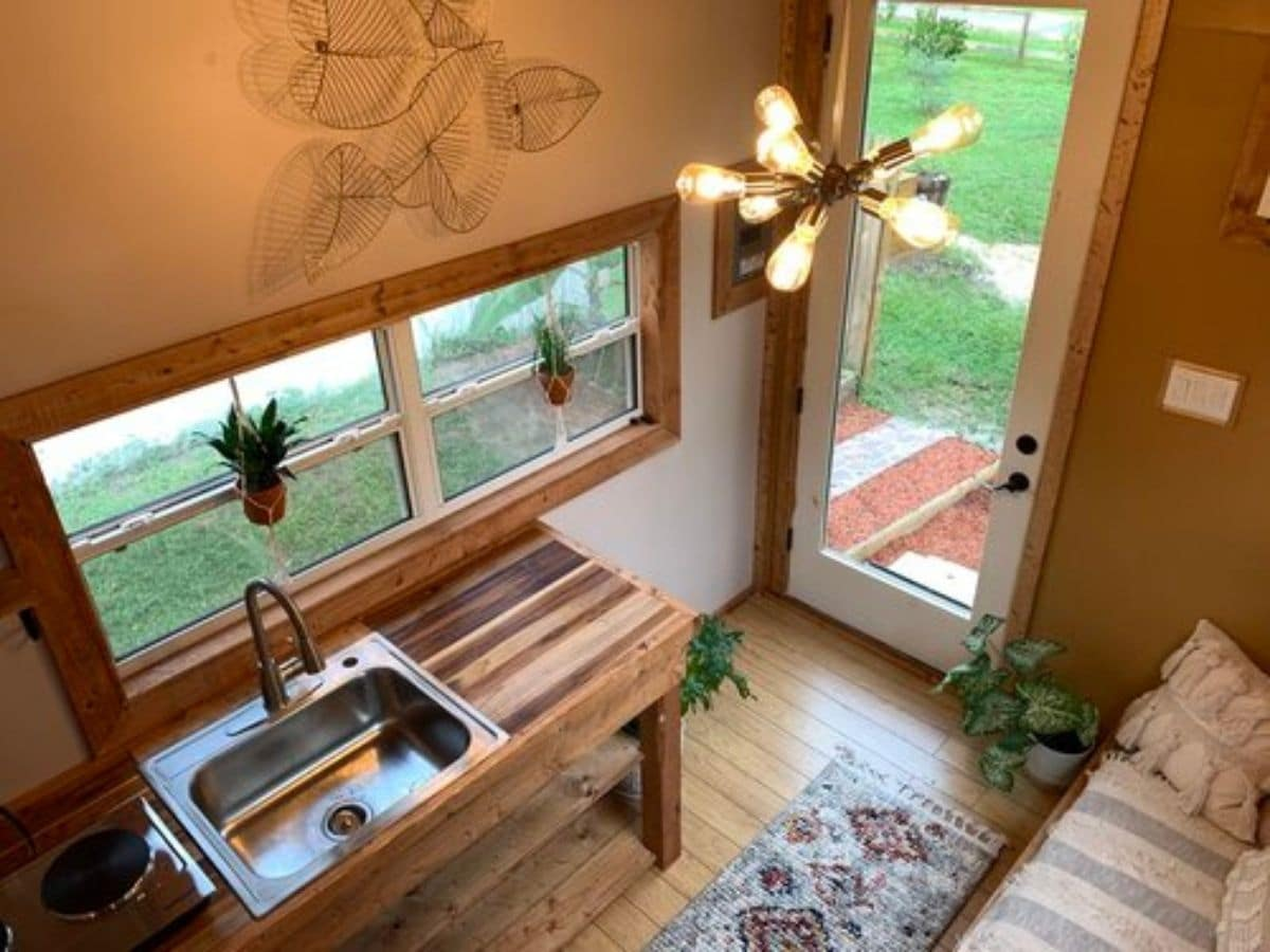 view of kitchenette and front door from loft