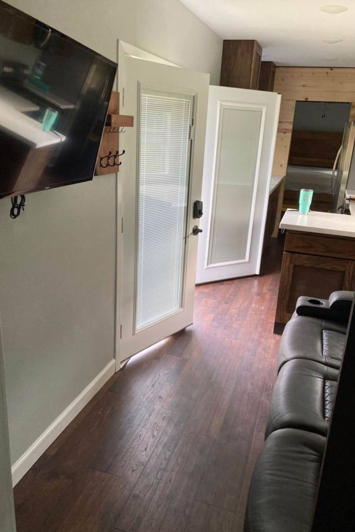 French doors opening into kitchen in tiny home