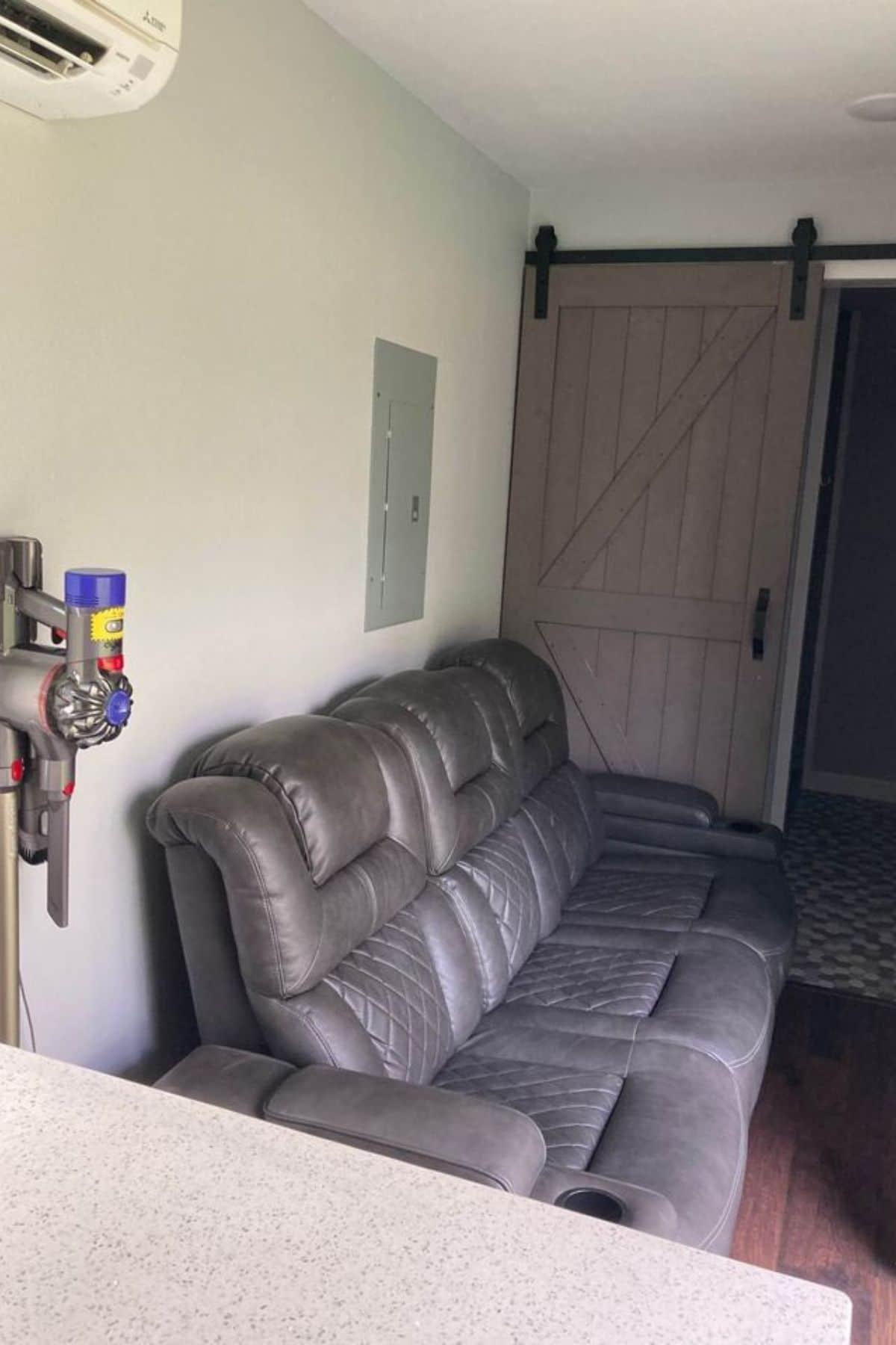 Gray sofa next to kitchen counter