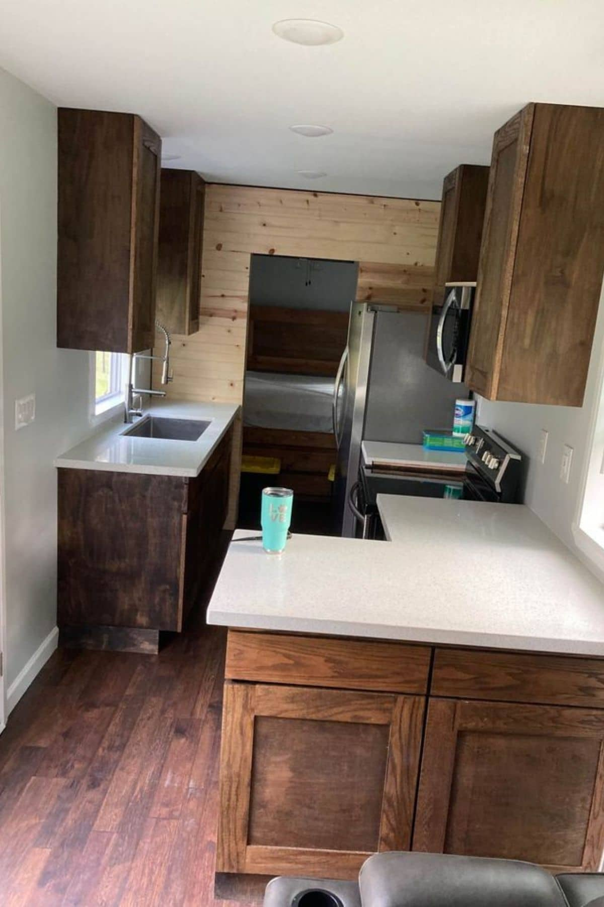 Wooden kitchen cabinets with white countertops
