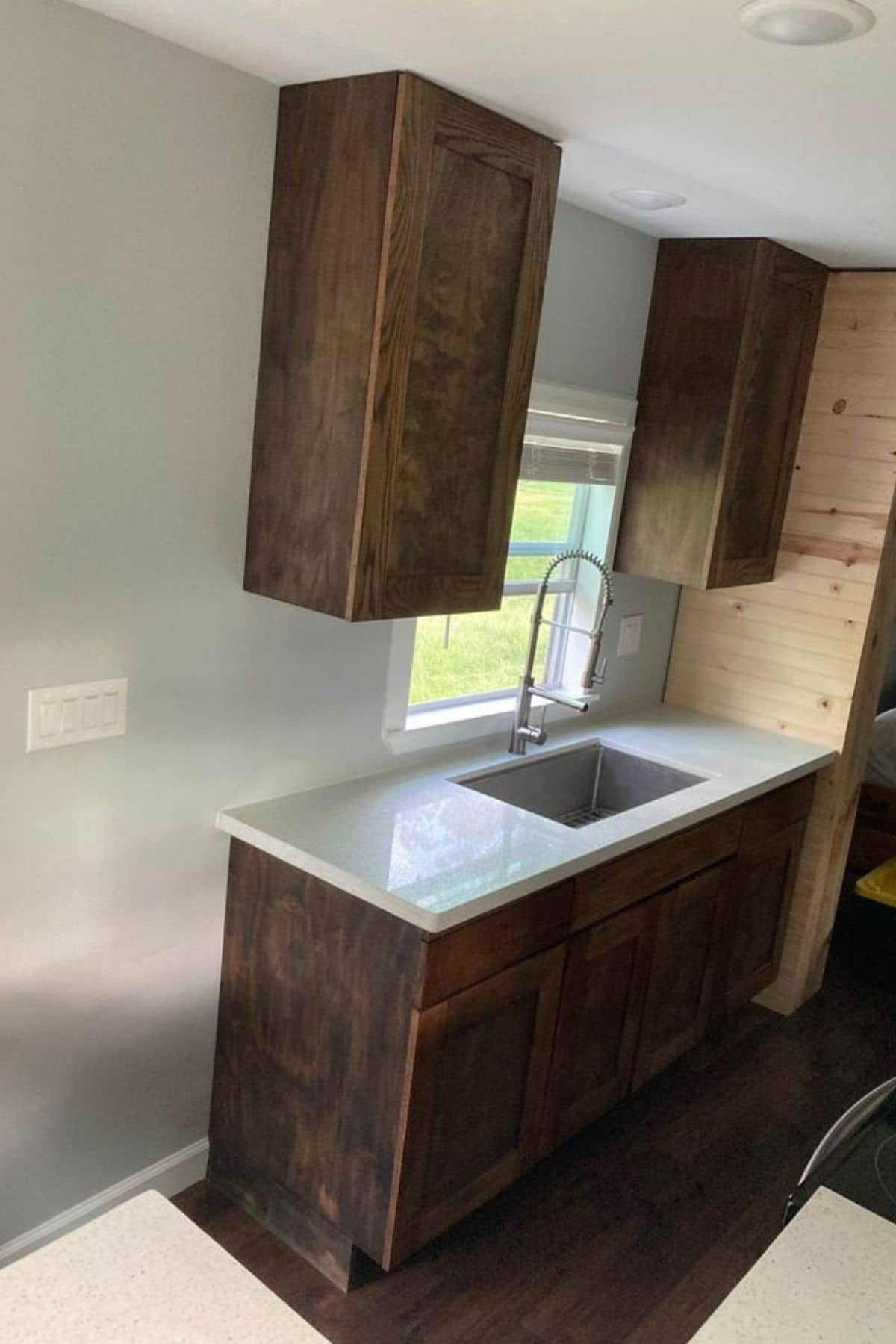 Kitchen counter against white wall with stainless steel sink