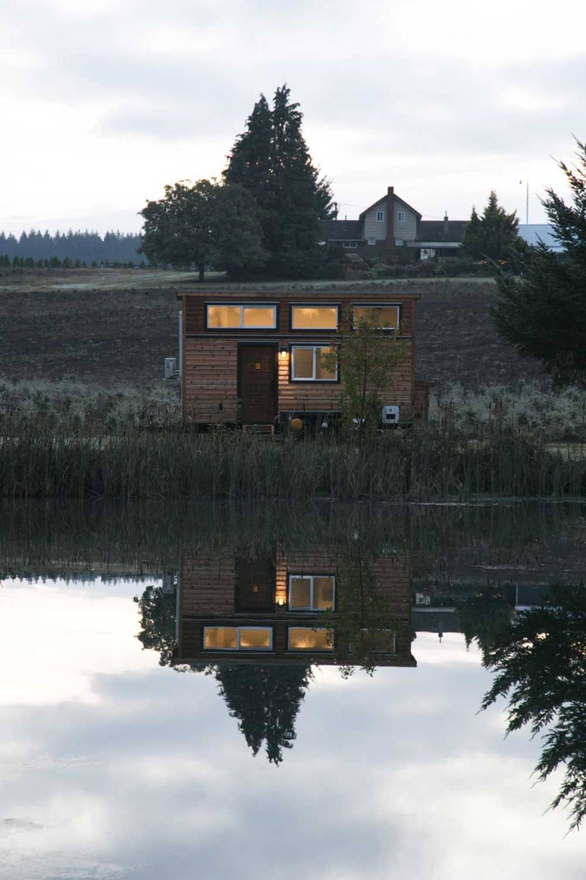 Tiny home reflection on water