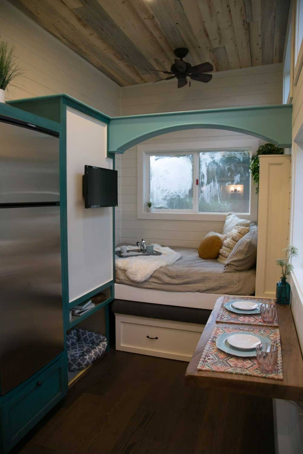 View of living space with convertible sofa bed in tiny home