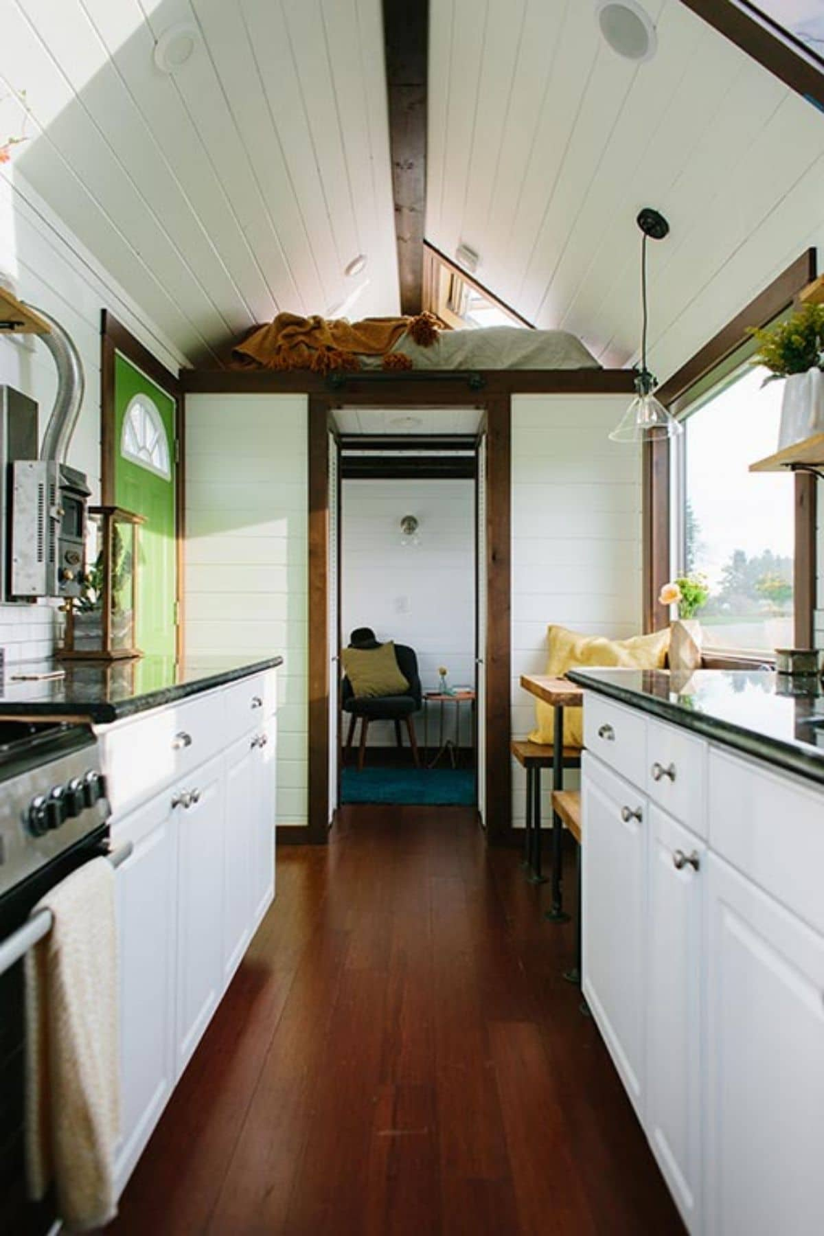 View of tiny house kitchen with white cabinets