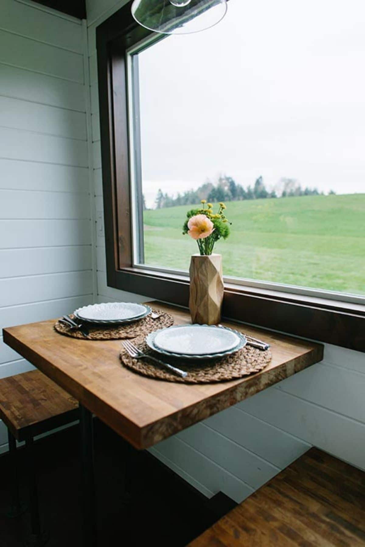 Dining table under window with bench seat