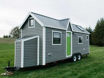 Gray tiny house with bright green door