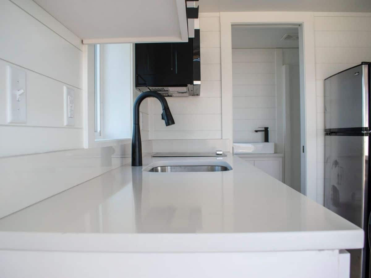 View across white counter top in tiny kitchen