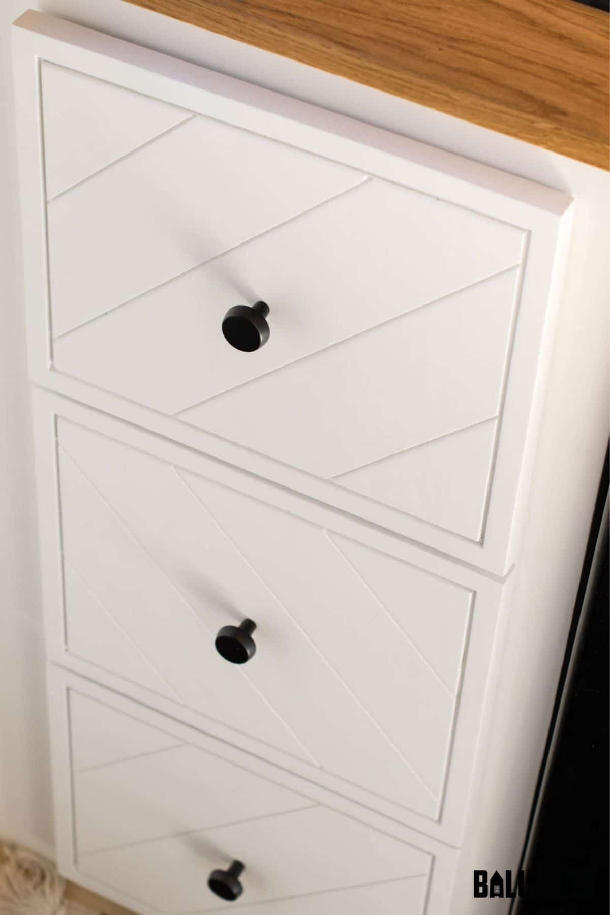 White cabinet with drawers in kitchen