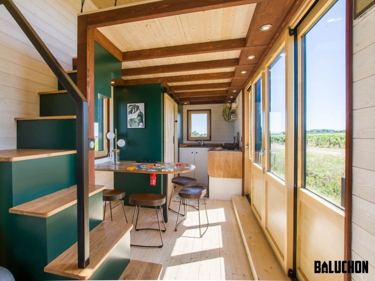 View down middle of tiny home with green stairs in foreground