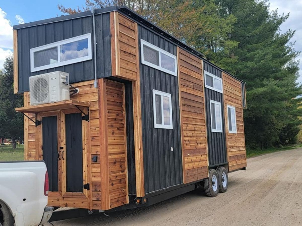 wood tiny home with black siding trim