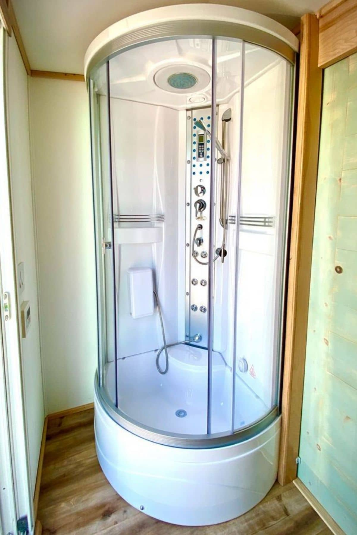 white corner rounded shower stall with multi-jet shower head system
