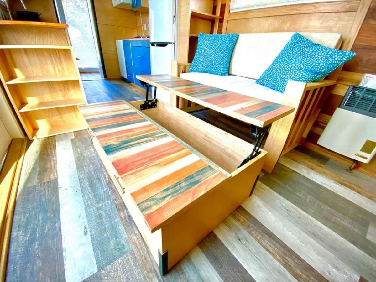 Reclaimed wood bench seat with blue pillows