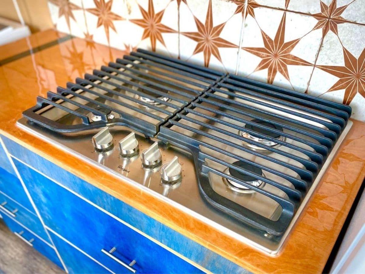 gas burner cooktop on butcher block counters