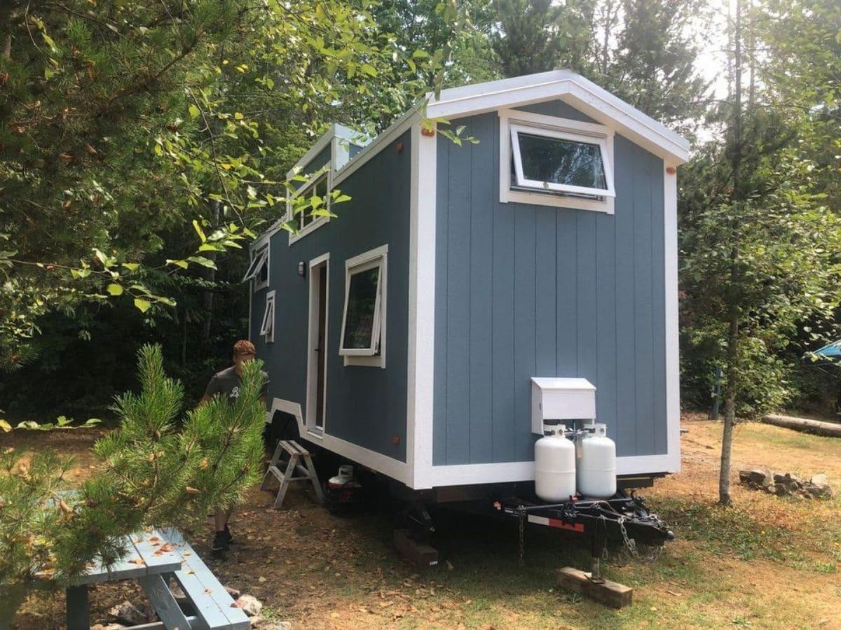 gray blue tiny house with white trim