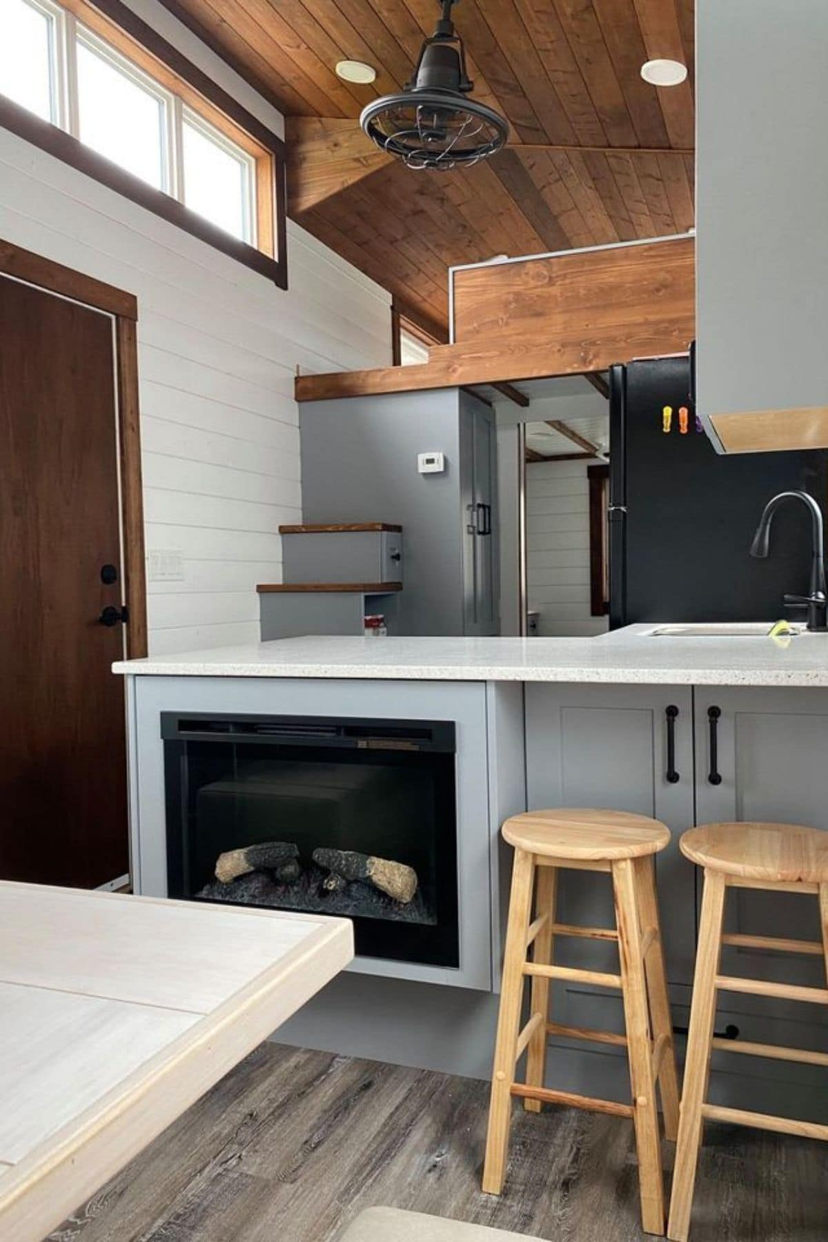 bar stools next to fireplace in kitchen cabinet