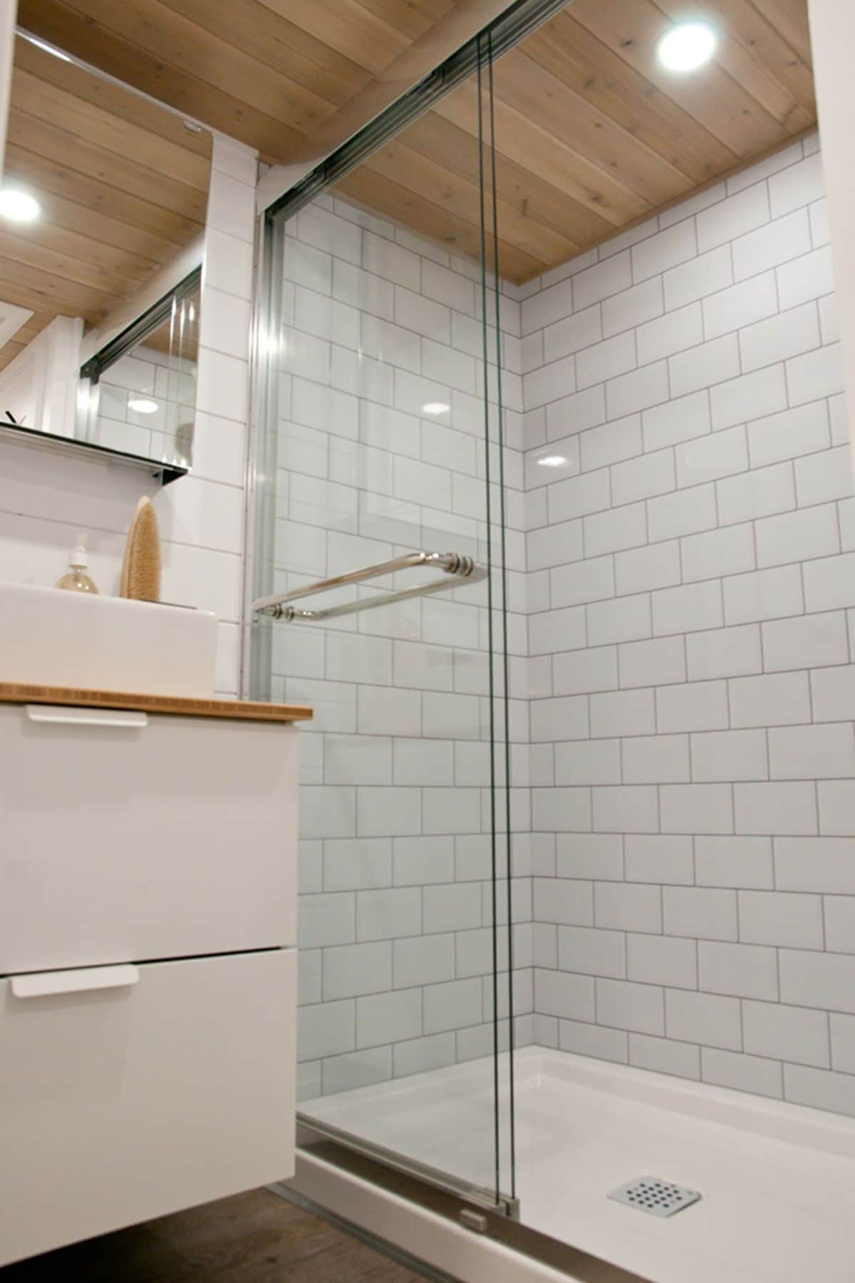tiled walk in shower in tiny house bathroom