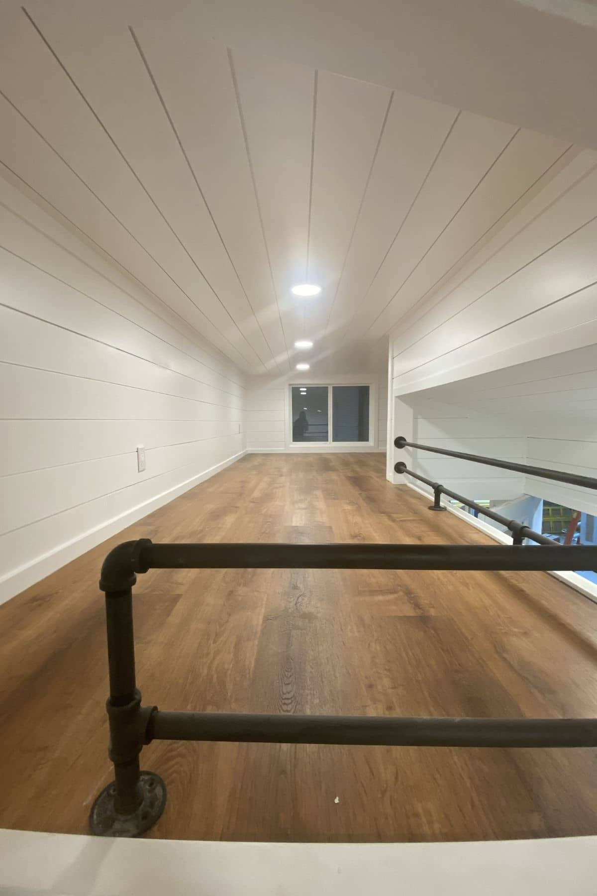 view into deep loft with half wall at end