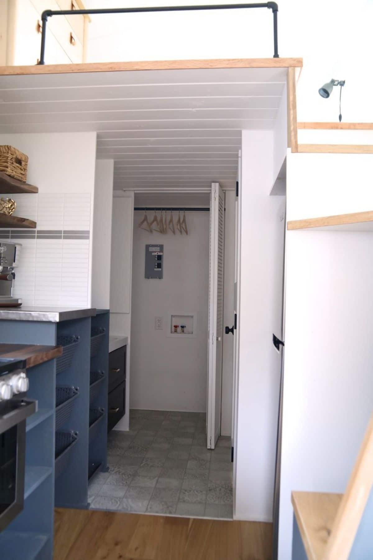 view into bathroom from kitchen with white walls and blue counters