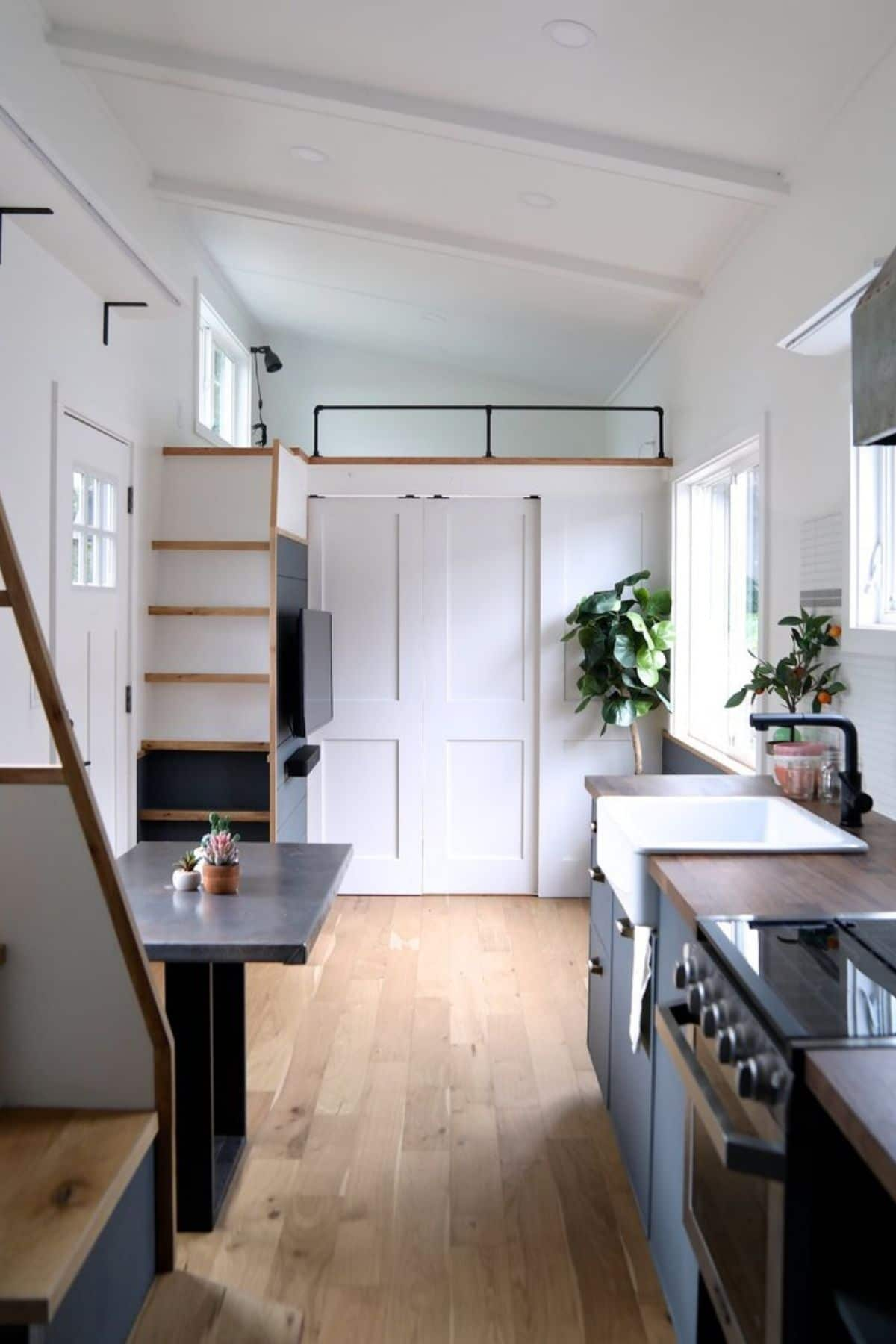 view from kitchen to bedroom at end of tiny home