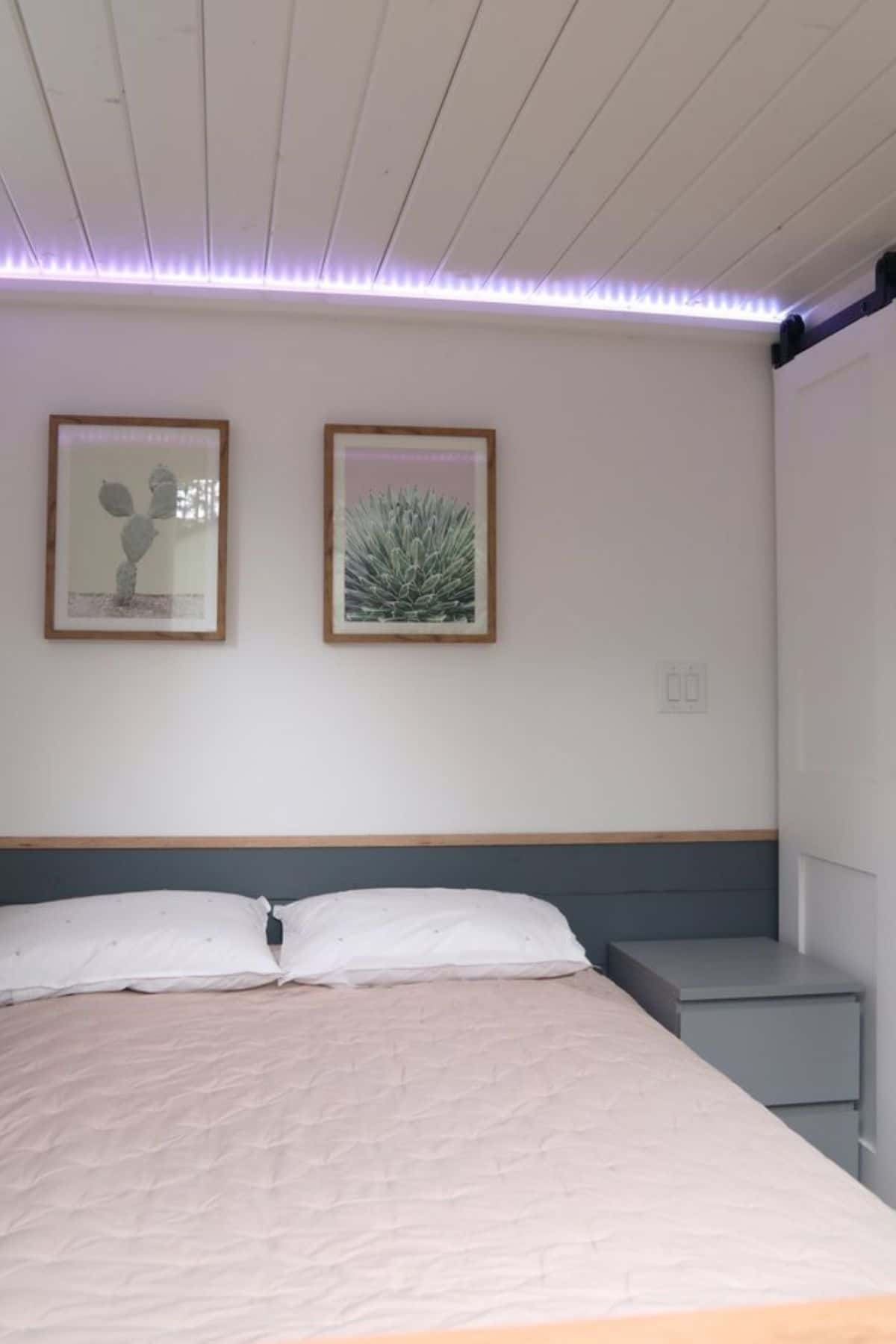 Bedroom with small bed and light pink bedding