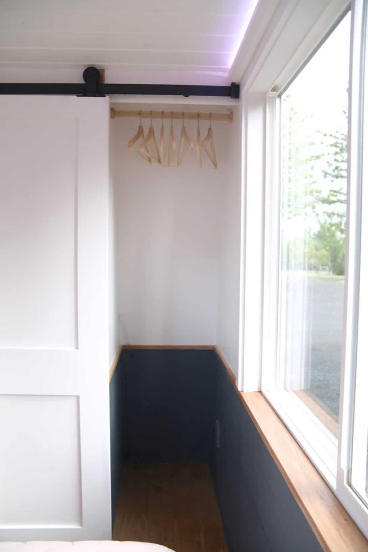 view into closet with hangers on rod