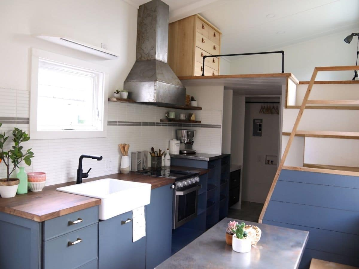 dining table on right side of kitchen by stairs