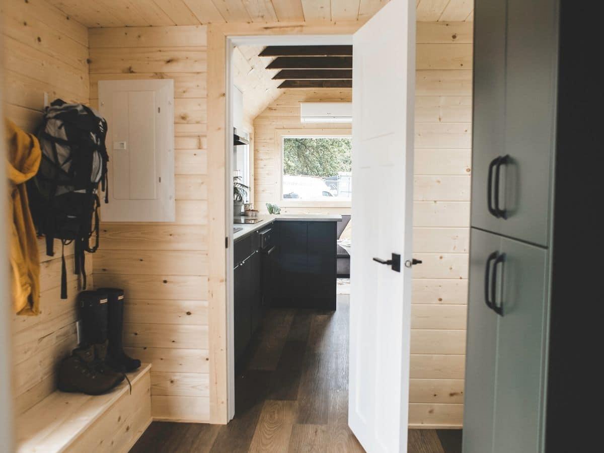 open door of mud room looking into kitchen