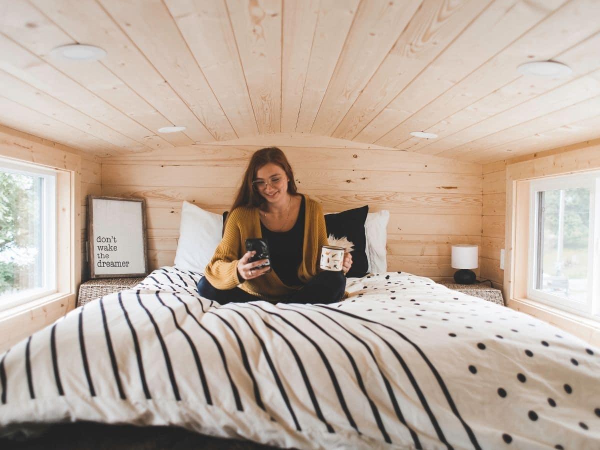 woman on bed in loft