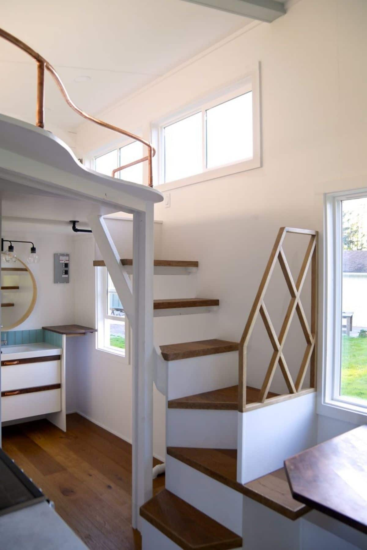 stairs to loft on right of image with vanity behind stairs