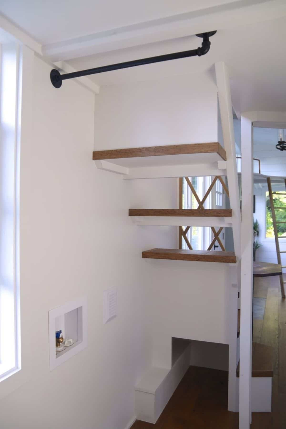 open space below stairs to loft