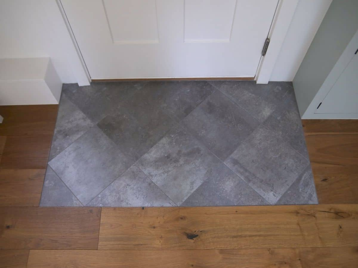 tile entryway next to wood flooring