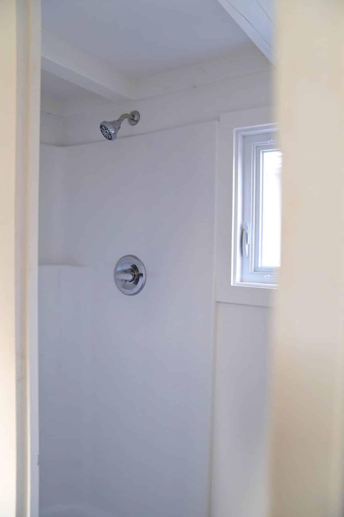 white shower stall through bathroom door