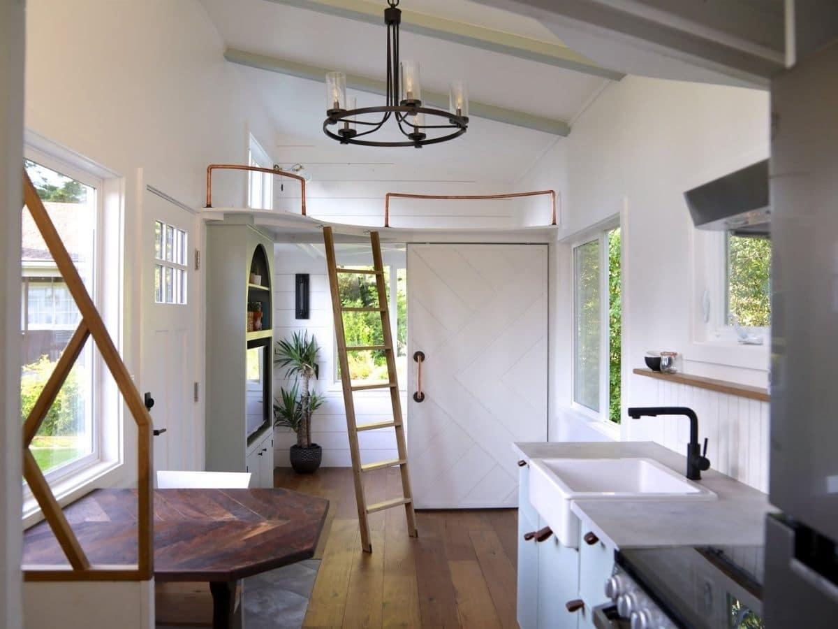 kitchen in foreground with open bedroom door in background