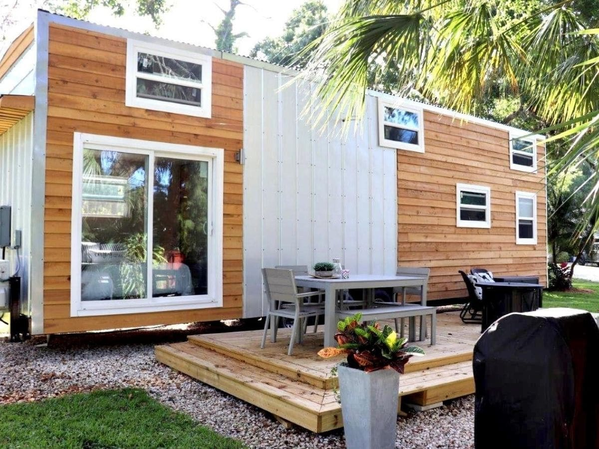 wood and white siding on tiny home with wood porch