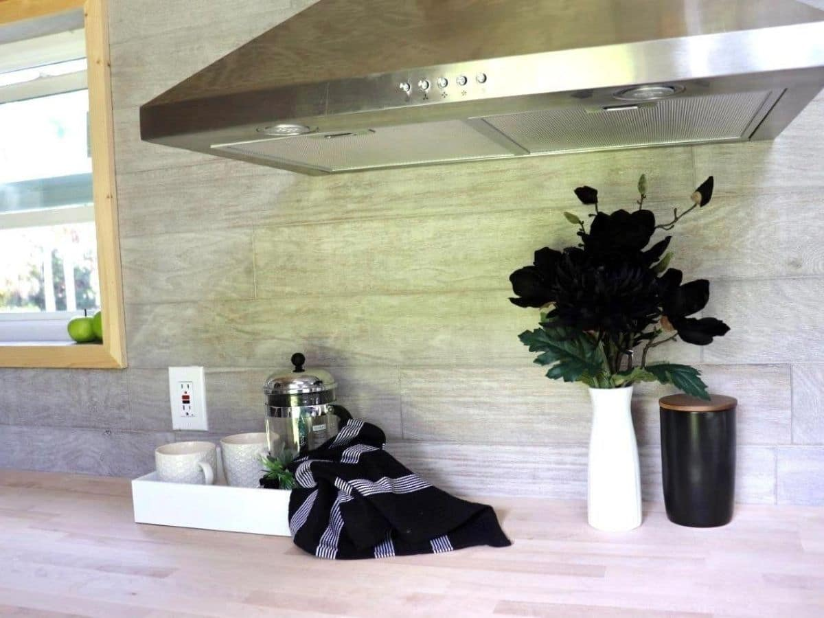 stainless steel vent hood above light wood countertop