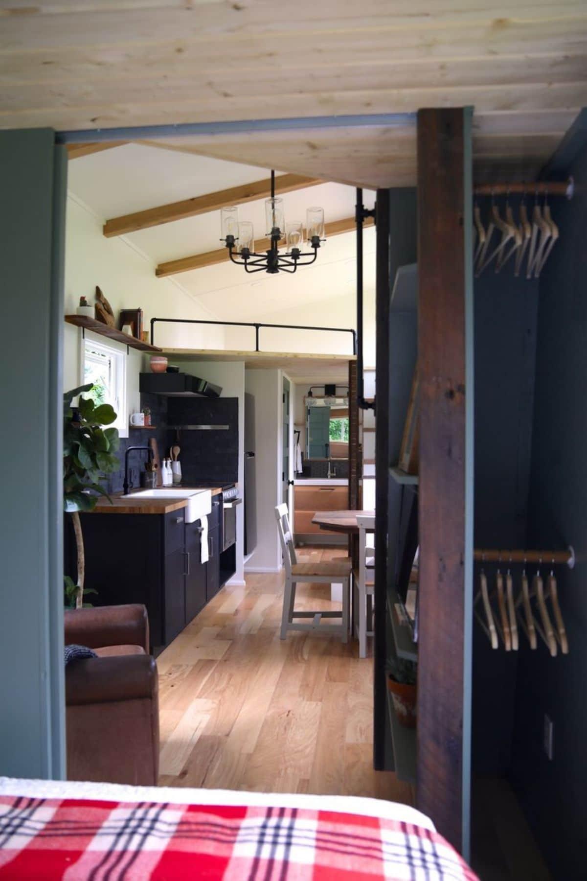 tiny bedroom with open door and closet to right of door