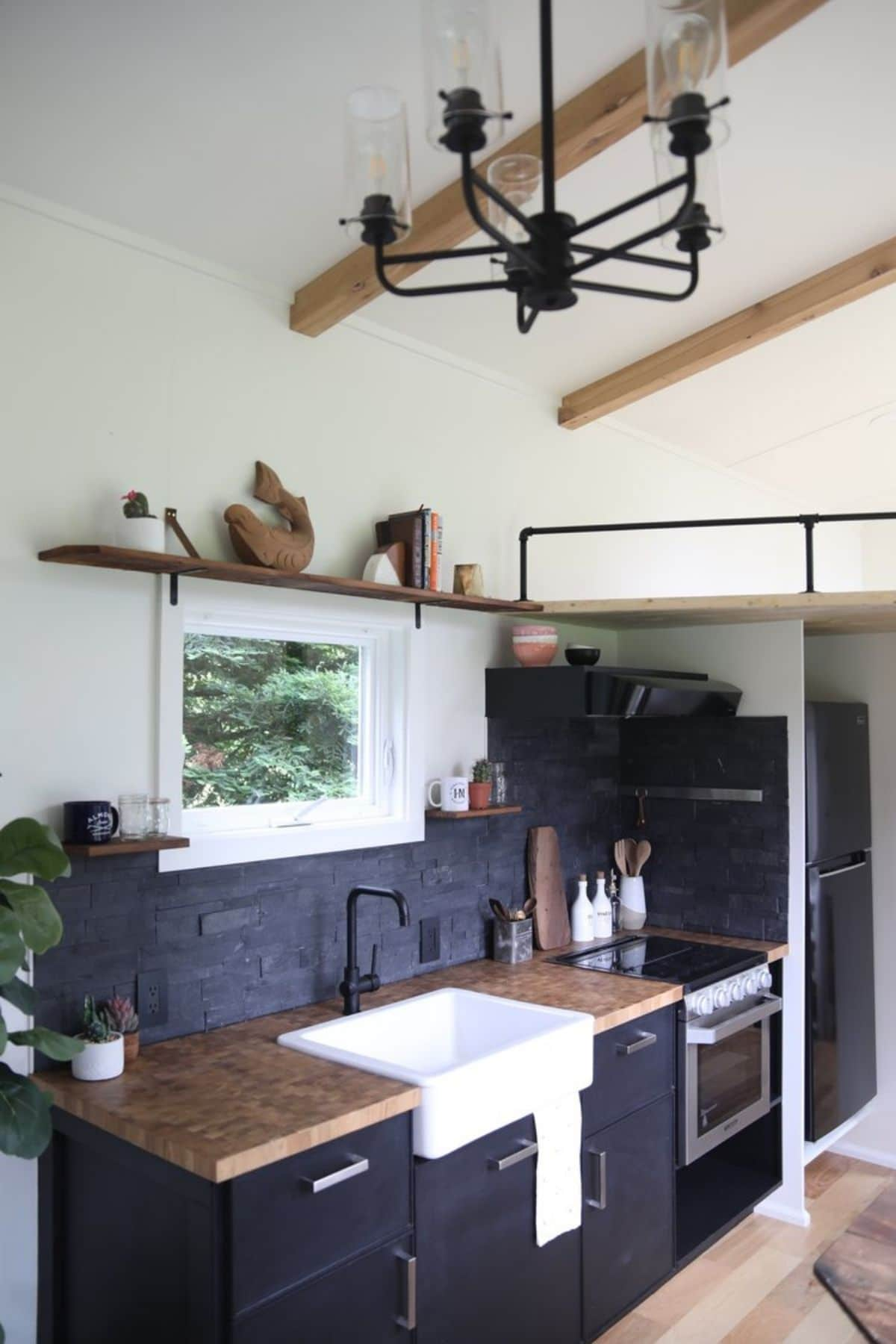 kitchen with dark cabinets and butcher block countertops