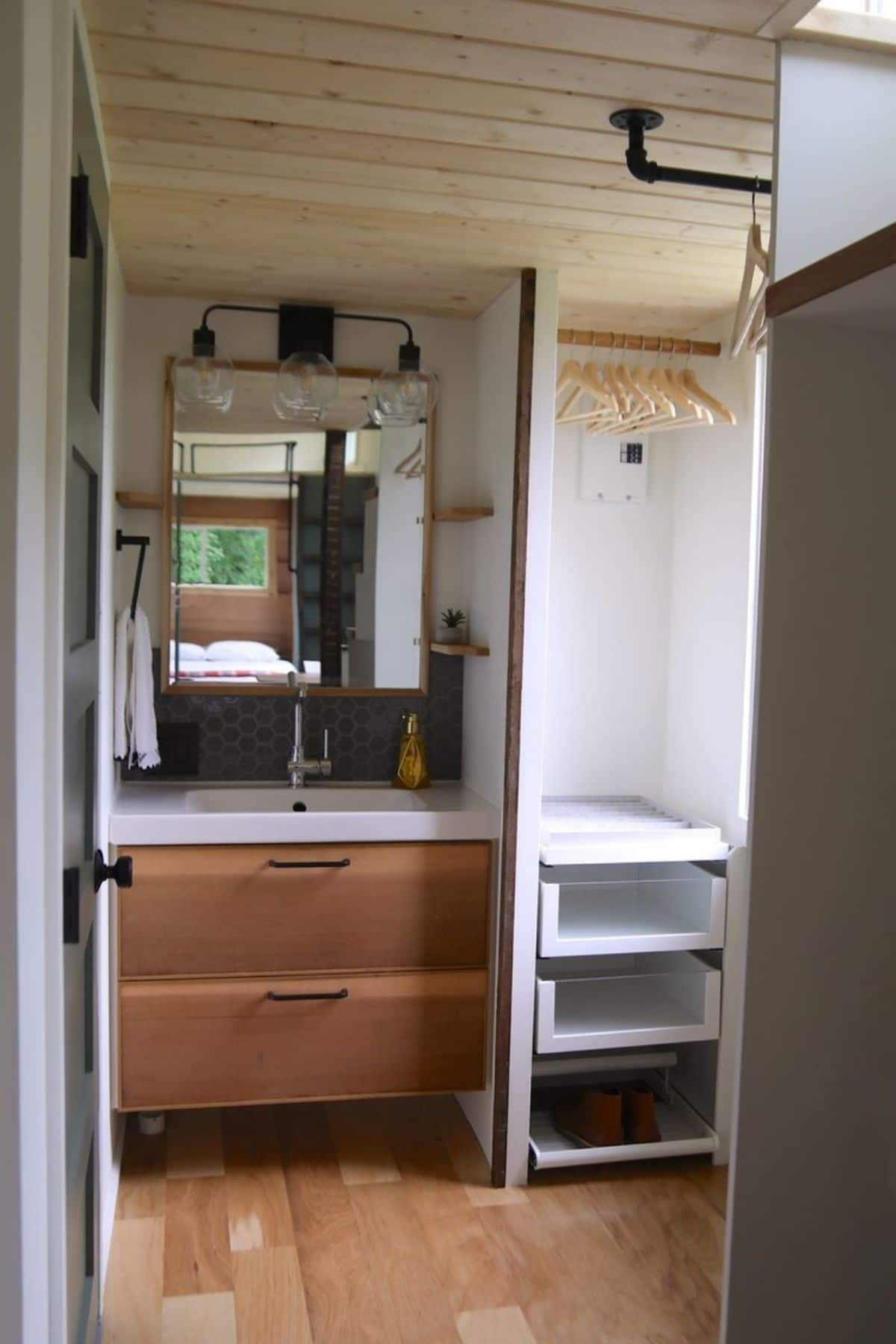 wood drawers under bathroom sink with open close to right